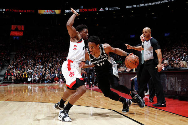 Nba Pro Basketball Art Print featuring the photograph Demar Derozan and Kyle Lowry by Mark Blinch