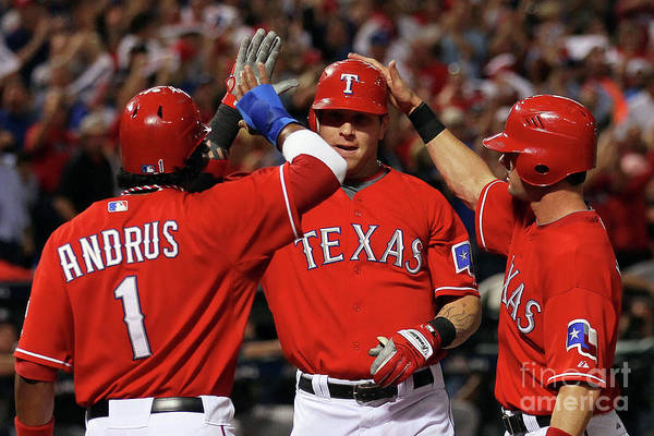Playoffs Art Print featuring the photograph Elvis Andrus, Michael Young, and Josh Hamilton by Stephen Dunn
