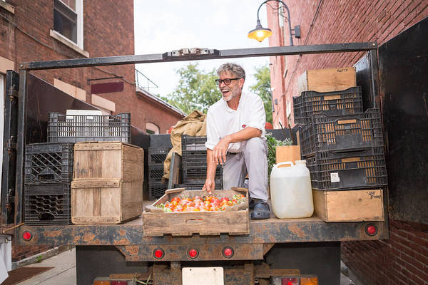 Working Art Print featuring the photograph Farmer unloading crates of organic tomatoes outside grocery store by Heshphoto