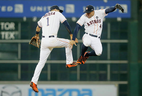 People Art Print featuring the photograph George Springer and Carlos Correa by Bob Levey