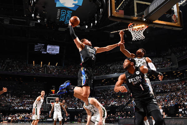 Nba Pro Basketball Art Print featuring the photograph Giannis Antetokounmpo and Blake Griffin by Jesse D. Garrabrant