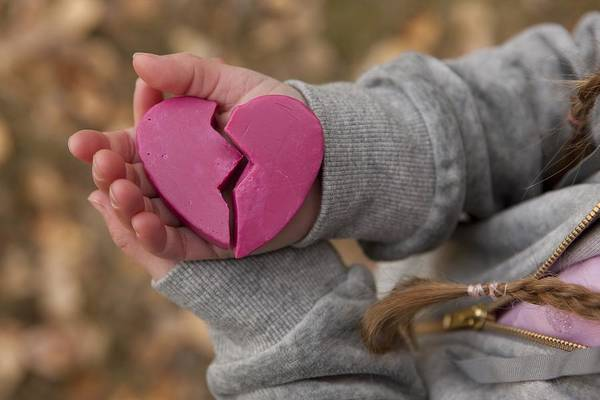 Child Art Print featuring the photograph Girl holding broken heart by Design Pics/Ron Nickel