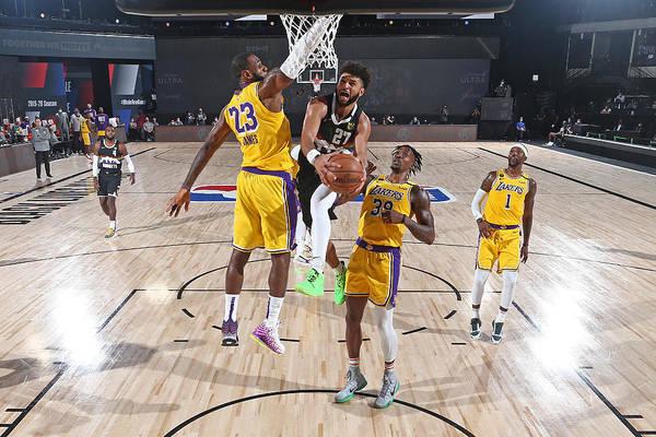 Nba Pro Basketball Art Print featuring the photograph Jamal Murray and Lebron James by Garrett Ellwood