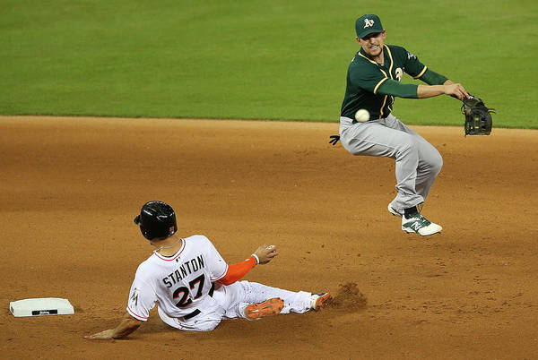 Double Play Art Print featuring the photograph Jed Lowrie and Giancarlo Stanton by Mike Ehrmann