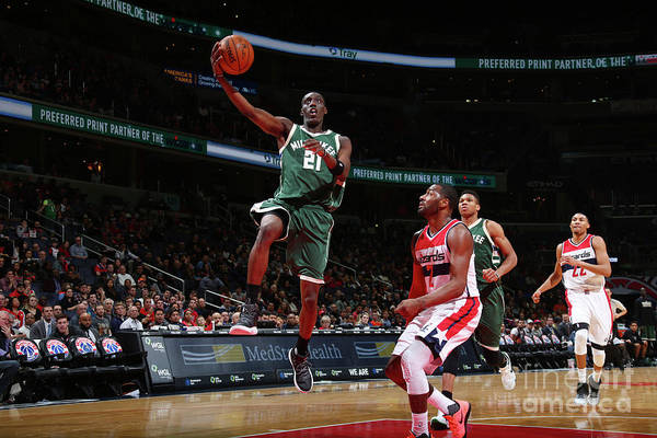Nba Pro Basketball Art Print featuring the photograph John Wall and Tony Snell by Ned Dishman