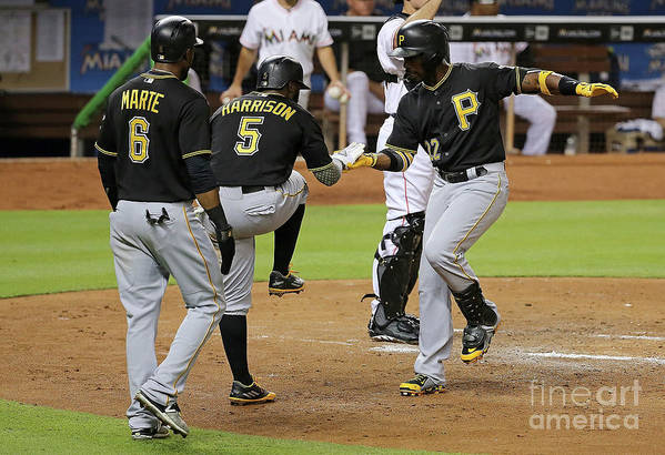 People Art Print featuring the photograph Josh Harrison, Andrew Mccutchen, and Starling Marte by Mike Ehrmann