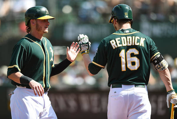 Ninth Inning Art Print featuring the photograph Josh Reddick and Josh Donaldson by Thearon W. Henderson