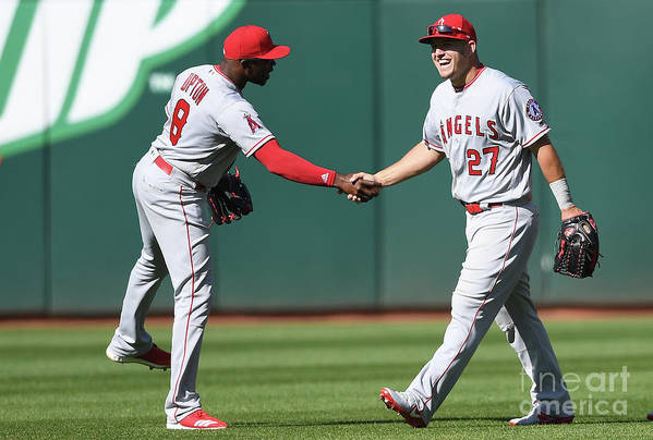 American League Baseball Art Print featuring the photograph Justin Upton and Mike Trout by Thearon W. Henderson
