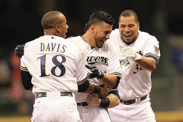 Celebration Art Print featuring the photograph Khris Davis, Wily Peralta, and Yovani Gallardo by Mike Mcginnis