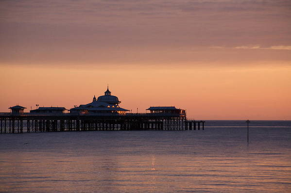 Sea Art Print featuring the photograph Llandudno pier at dawn by Christopher Rowlands