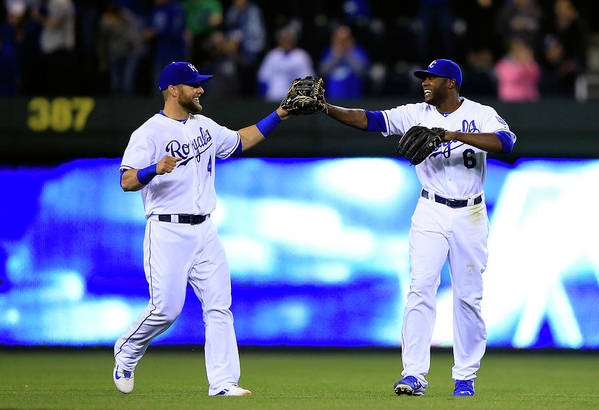 American League Baseball Art Print featuring the photograph Lorenzo Cain and Alex Gordon by Jamie Squire