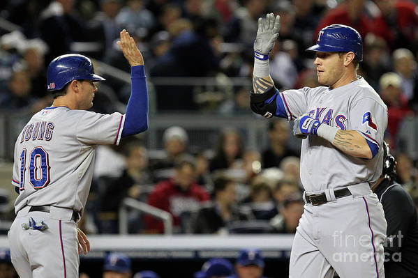 Playoffs Art Print featuring the photograph Michael Young and Josh Hamilton by Al Bello