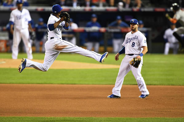 Playoffs Art Print featuring the photograph Mike Moustakas and Alcides Escobar by Rob Tringali