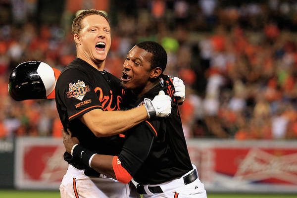 American League Baseball Art Print featuring the photograph Nick Hundley and Adam Jones by Rob Carr