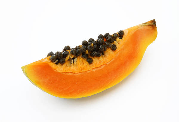 Orange Color Art Print featuring the photograph Quarater of a fresh, ripe papaya or paw paw. by Rosemary Calvert