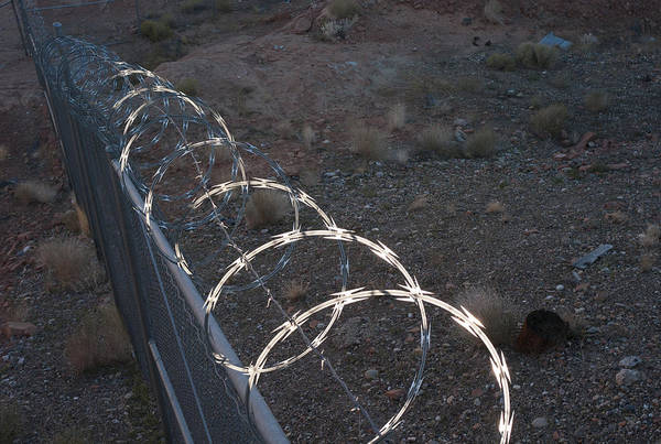Geology Art Print featuring the photograph Razor wire on a fence on the coast by Fotosearch