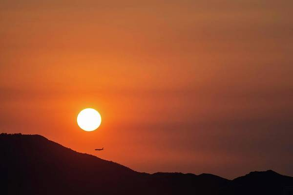 Sunset Art Print featuring the photograph Red sunset and plane in flight by Hannes Roeckel