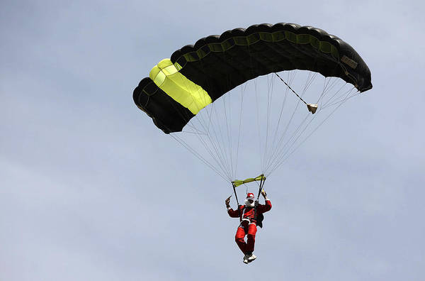 Internet Art Print featuring the photograph Skydiving Santas Launch New Experiences Website by Brendon Thorne
