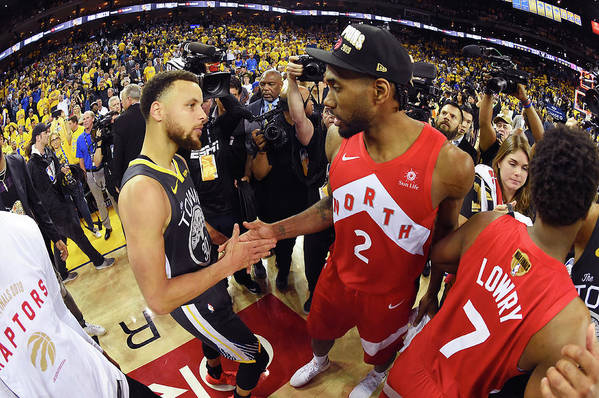 Playoffs Art Print featuring the photograph Stephen Curry and Kawhi Leonard by Andrew D. Bernstein