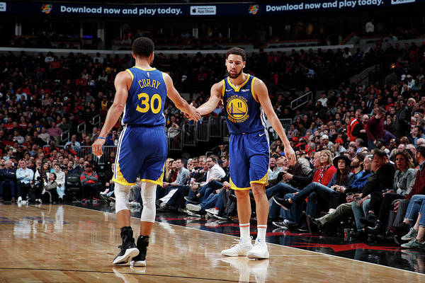 Nba Pro Basketball Art Print featuring the photograph Stephen Curry and Klay Thompson by Jeff Haynes