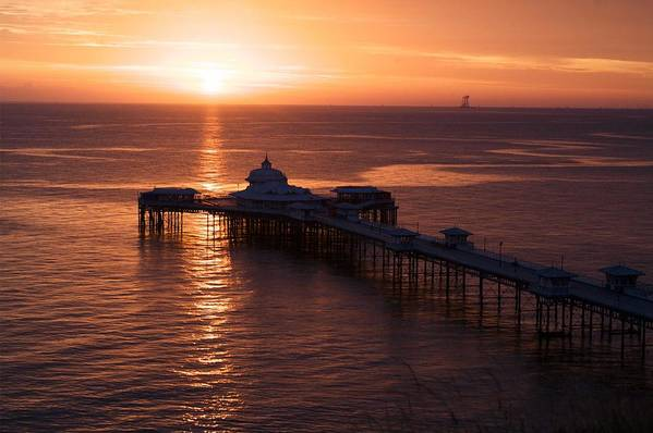 Piers Art Print featuring the photograph Sunrise over Llandudno pier 2 by Christopher Rowlands