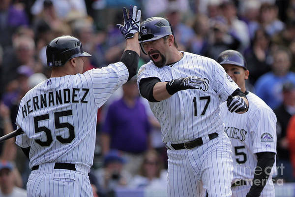 Relief Pitcher Art Print featuring the photograph Todd Helton And Ramon Hernandez by Doug Pensinger