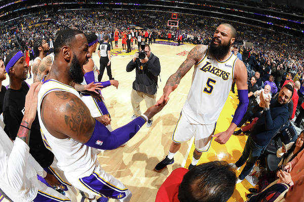 Nba Pro Basketball Art Print featuring the photograph Tyson Chandler and Lebron James by Andrew D. Bernstein