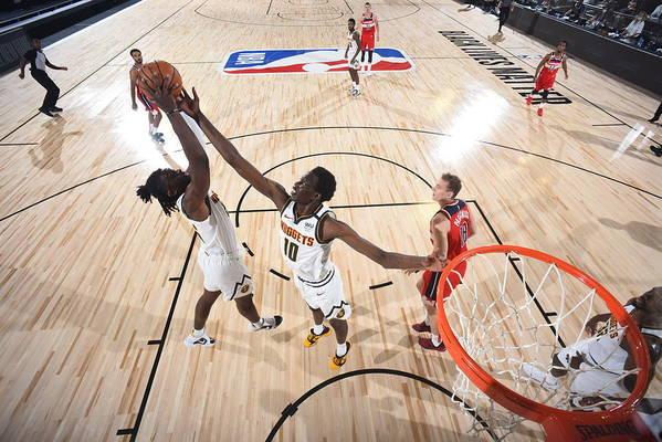 Nba Pro Basketball Art Print featuring the photograph Washington Wizards v Denver Nuggets by Garrett Ellwood