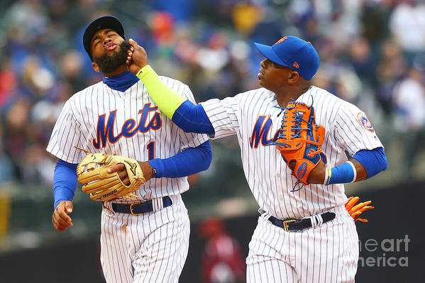 Yoenis Cespedes Art Print featuring the photograph Yoenis Cespedes and Amed Rosario by Mike Stobe