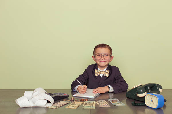 Working Art Print featuring the photograph Young Boy Accountant Records Taxes to be Paid by Andrew Rich