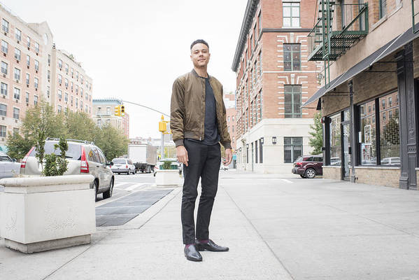 People Art Print featuring the photograph Young man standing on city sidewalk by Tony Anderson