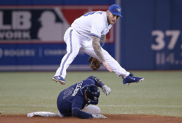Double Play Art Print featuring the photograph Yunel Escobar and Brett Lawrie by Tom Szczerbowski