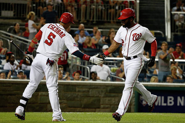People Art Print featuring the photograph Yunel Escobar and Denard Span by Rob Carr