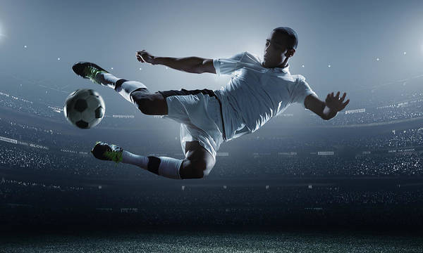 Goal Art Print featuring the photograph Soccer Player Kicking Ball In Stadium by Dmytro Aksonov