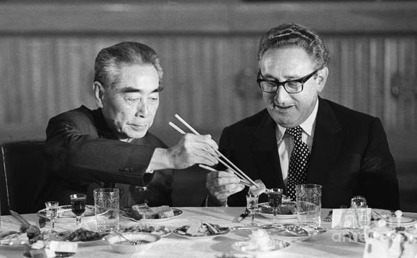 Chinese Culture Art Print featuring the photograph Kissinger Eating With Zhou Enlai by Bettmann