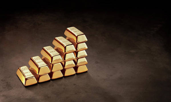 In A Row Art Print featuring the photograph Stepped Stack Of Gold On Dark Surface by Anthony Bradshaw