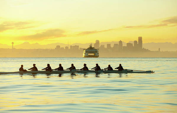 Sport Rowing Art Print featuring the photograph Team Rowing Boat In Bay by Pete Saloutos