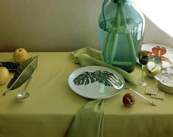 Table Setting Art Print featuring the photograph Plates, Apples And A Vase On A Green Tablecloth by Horst P. Horst