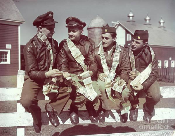 Young Men Art Print featuring the photograph Air Force Gunners Comparing Short by Bettmann