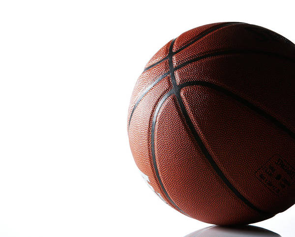 Recreational Pursuit Art Print featuring the photograph Basketball On White Background by Thomas Northcut