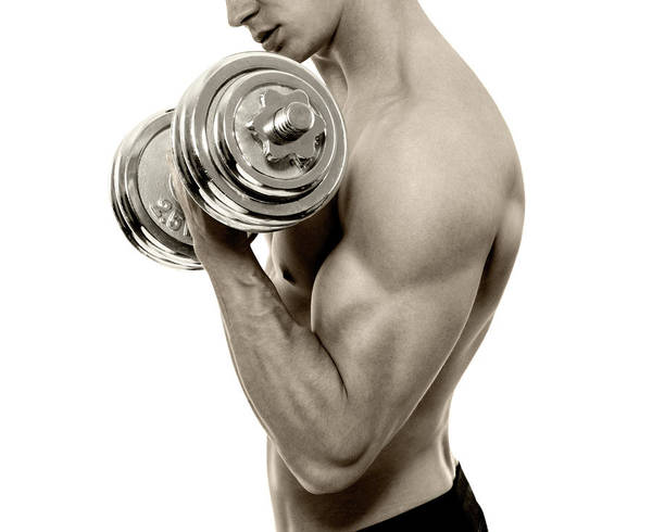 Young Men Art Print featuring the photograph Body Builder Exercising by Gilaxia