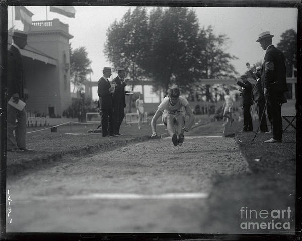 The Olympic Games Art Print featuring the photograph Carl Johnson Making His Jump In Olympic by Bettmann