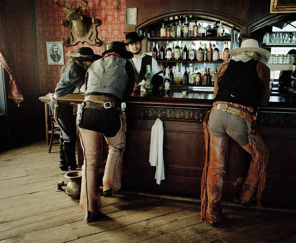 Young Men Art Print featuring the photograph Cowboys At Saloon by Matthias Clamer