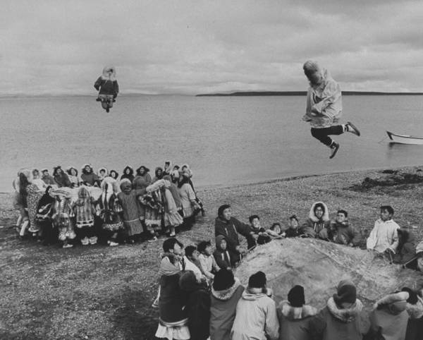 Timeincown Art Print featuring the photograph Eskimos Using Homemade Trampolines To Ce by Ralph Crane