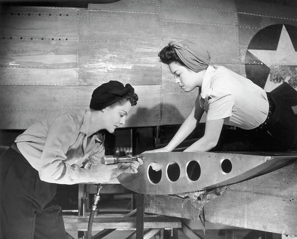Working Art Print featuring the photograph Female Workers Working On Plane by George Marks