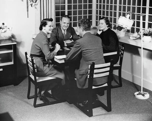 Heterosexual Couple Art Print featuring the photograph Group At A Table by George Marks