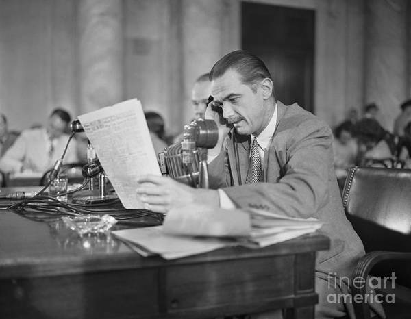 Howard Hughes Art Print featuring the photograph Howard Hughes Testifying During Senate by Bettmann