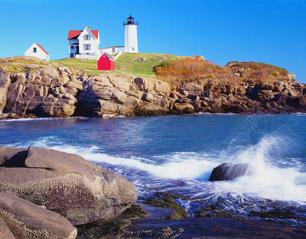 Water's Edge Art Print featuring the photograph Nubble Lighthouse And Coastine Of Maine by Ron thomas