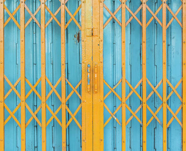 Handle Art Print featuring the photograph Old Yellow And Blue Steel Door by Mories602