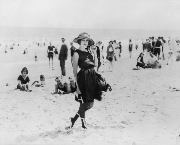 Straw Hat Art Print featuring the photograph On The Beach by American Stock Archive